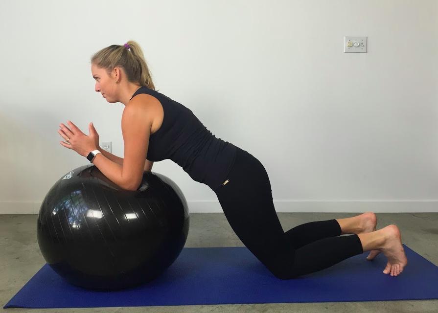 Static forearm plank on ball in kneeling (harder)