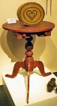 "Elliott and Grace Snyder of South Egremont, Massachusetts, showed this Moore County, North Carolina, stand in poplar with a red paint finish and a Museum of Early Southern Decorative Arts label in a drawer. It's 26¾"" high and $9500. The 9¼"" diameter round box, paint-decorated on a yellow ground, is from New England, probably Vermont, first quarter of the 19th century, and was $12,500."