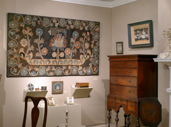 Hooked rugs at the booth of Elliott & Grace Snyder at the 2011 Winter Antiques Show