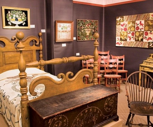 Elliott & Grace Snyder's display featured a circa 1835 bed with an 1820 crewelwork bedcovering; an 1816 painted dower chest from New York; an 1860s hooked rug, right; 1825 fancy chairs and a 1790 Windsor chair.