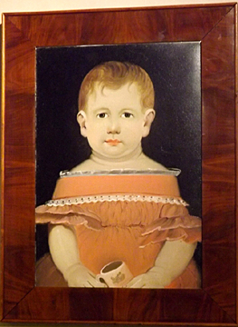 "The circa 1840 child's portrait, attributed to William Matthew Prior, shows the child in a salmon-colored dress, holding a pink cup. It is 14¾"" x 10¼"" (sight size)."