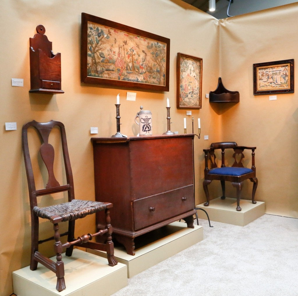 Elliott & Grace Snyder, South Egremont, Mass., believed that the diminutive one-drawer blanket chest at center was likely from Connecticut, circa 1760. It was in original condition including the red paint and shaped feet. The 1760 corner chair to the right of it was also likely from Connecticut, with a grain painted surface and heart cutout splats.