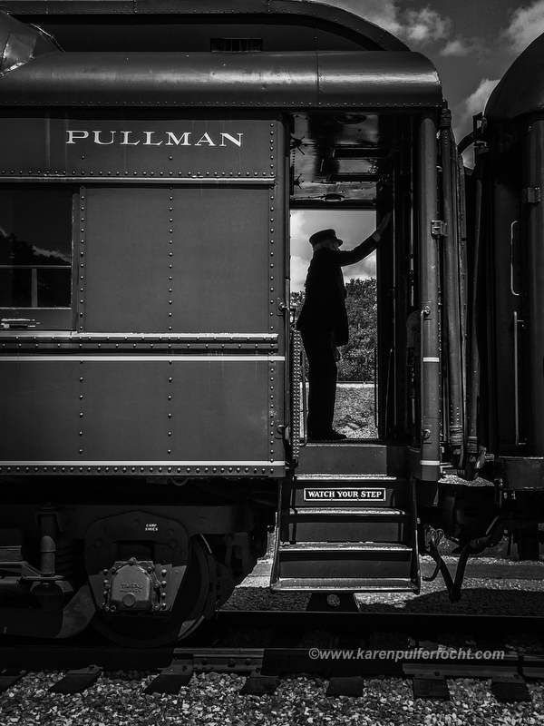 Mark Brainard, a Station Master, stands in the vestibule of a Pullman passenger car at the Chattanooga Railfest. This car, the Tennessee Valley Clover Colony of the Colony series, is from the 1920's. It was used in the film Some Like It Hot. Prints are available for purchase; inquire karenpulferfocht@gmail.com
