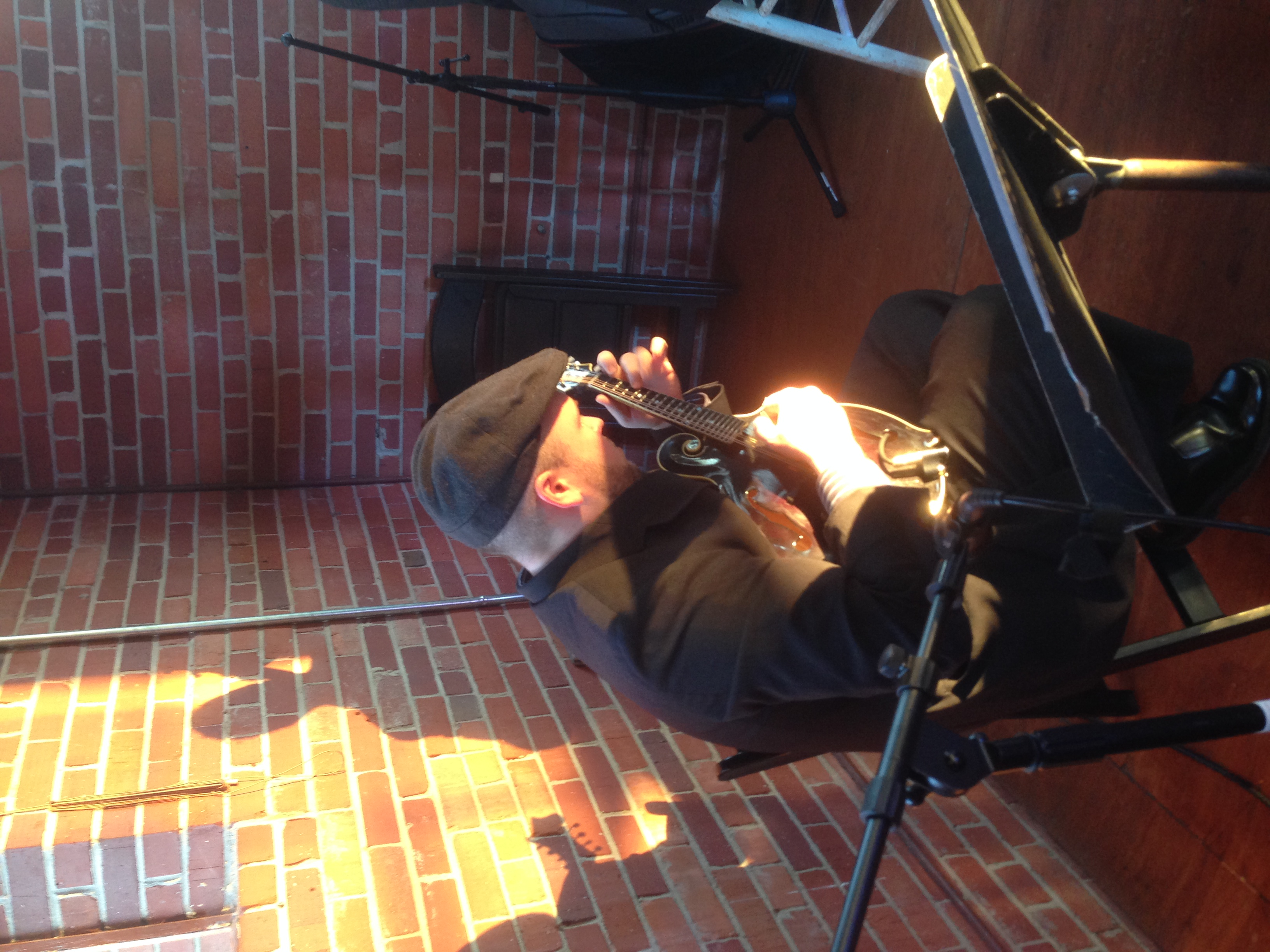 Jesse Jones, mandolinist rehearsing before the concert. I loved the way the sun was shining on his hands!