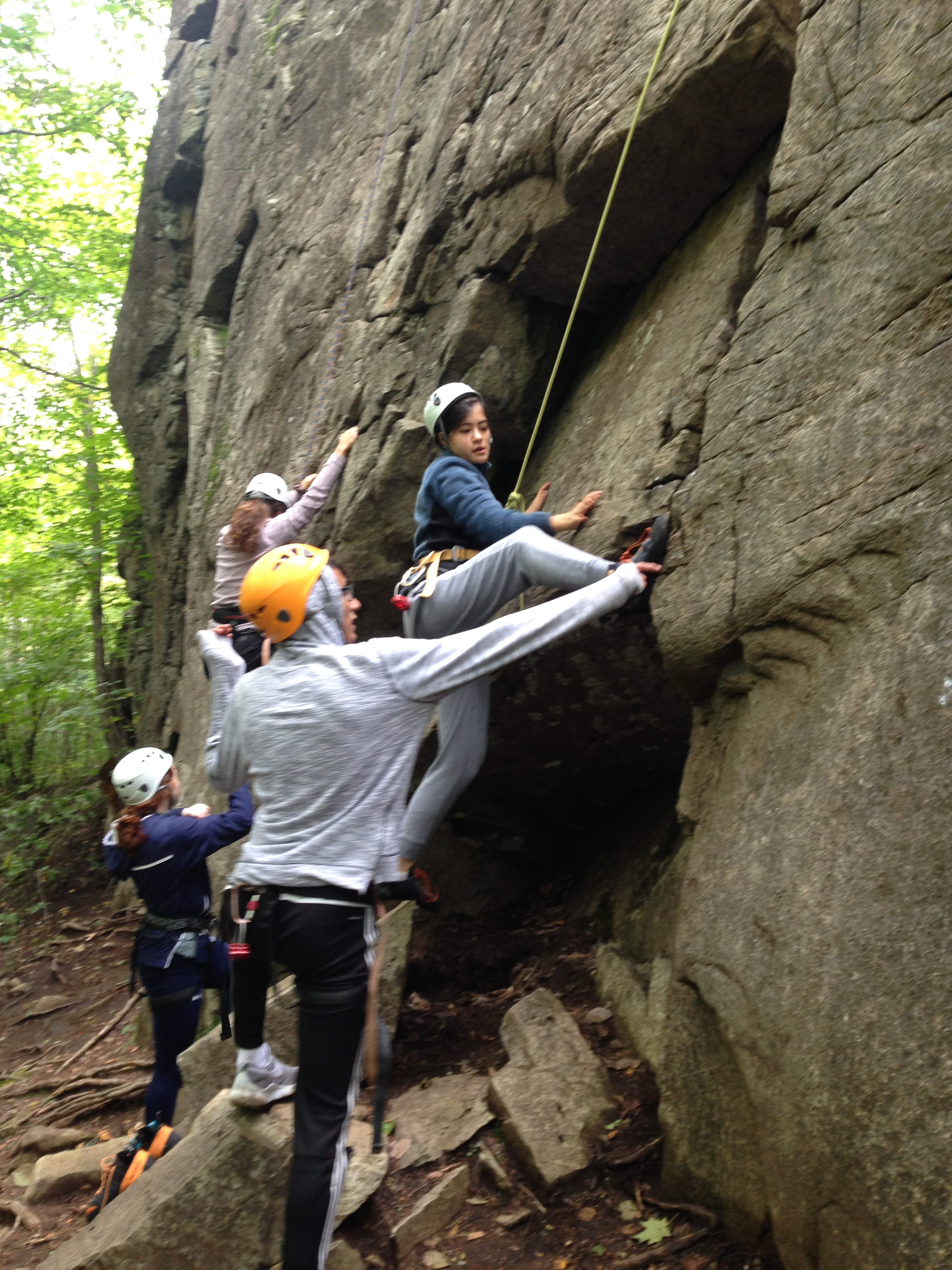 "Middlebury College Students work together to unlock the sequence on the start of ""North Country Club Crack"" in the Adirondack Park"