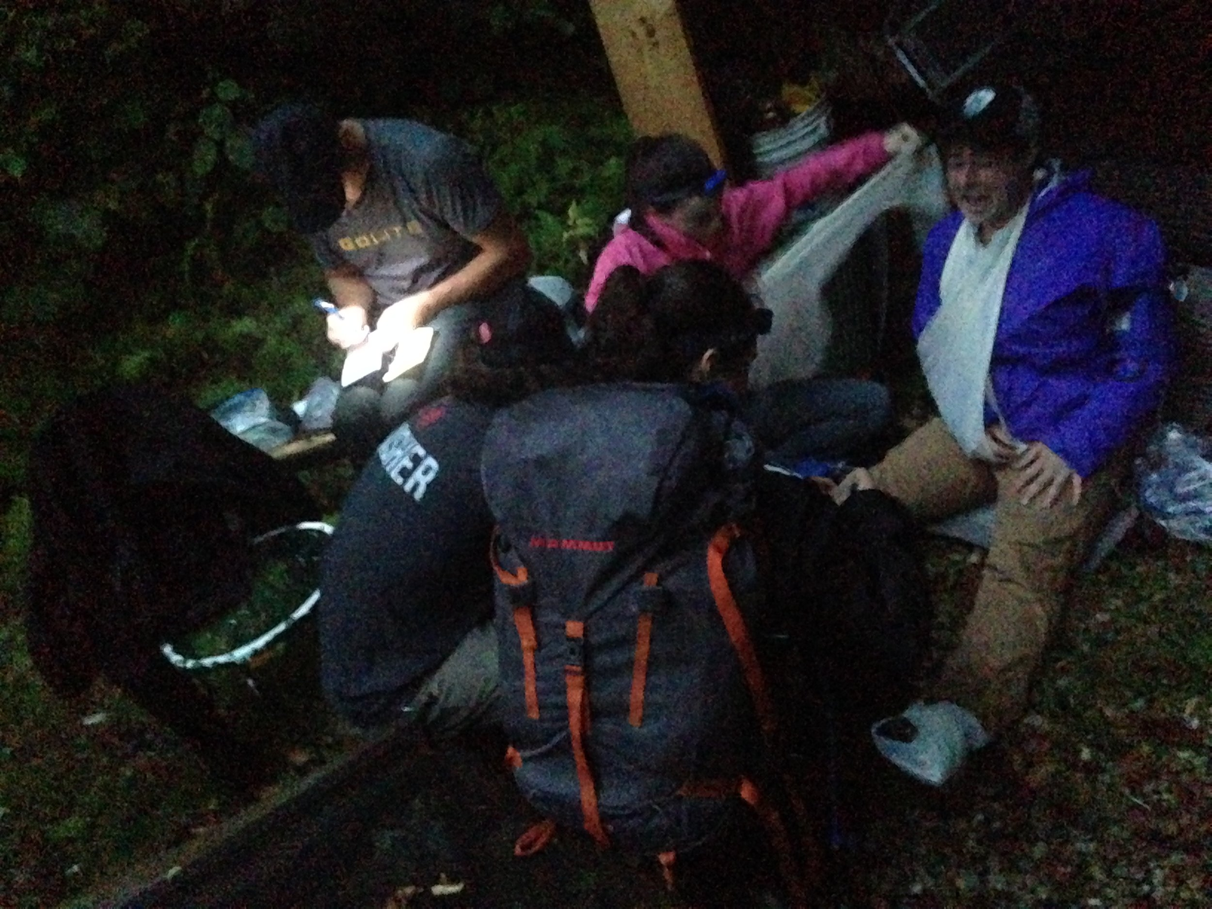 A college wilderness evacuation team trains at KMG HQ at night.  KMG instructors observe, evaluate, and debrief the Evac teams response in scenario based training.