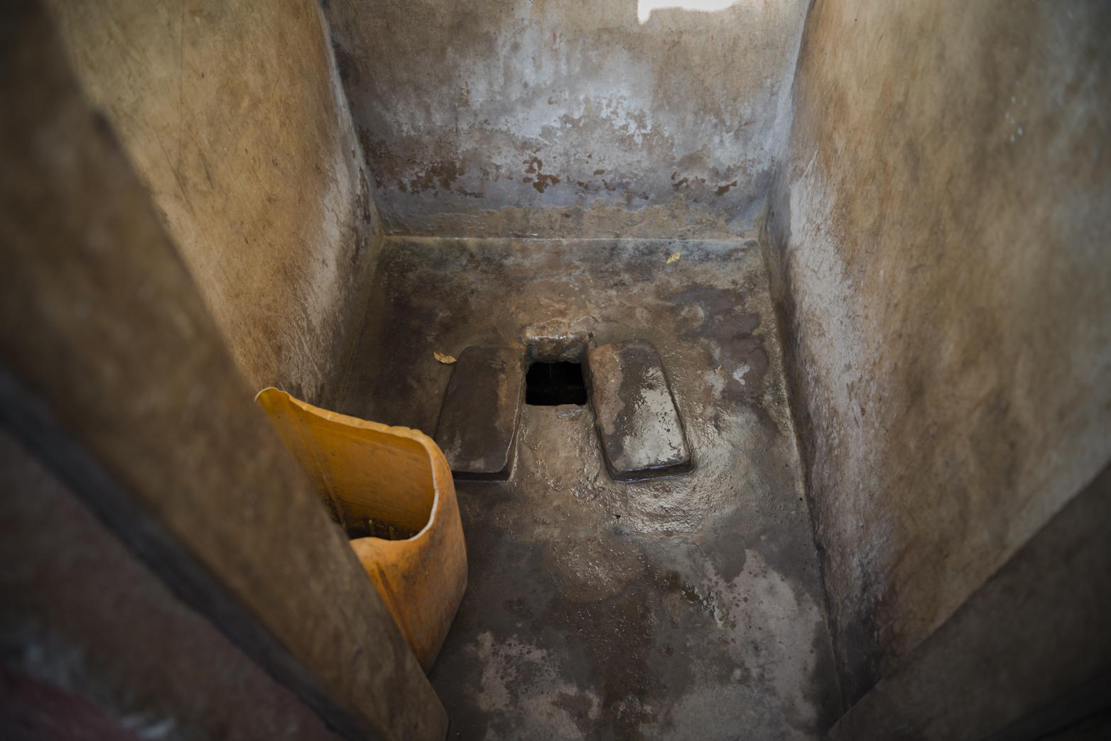 Drop hole toilet