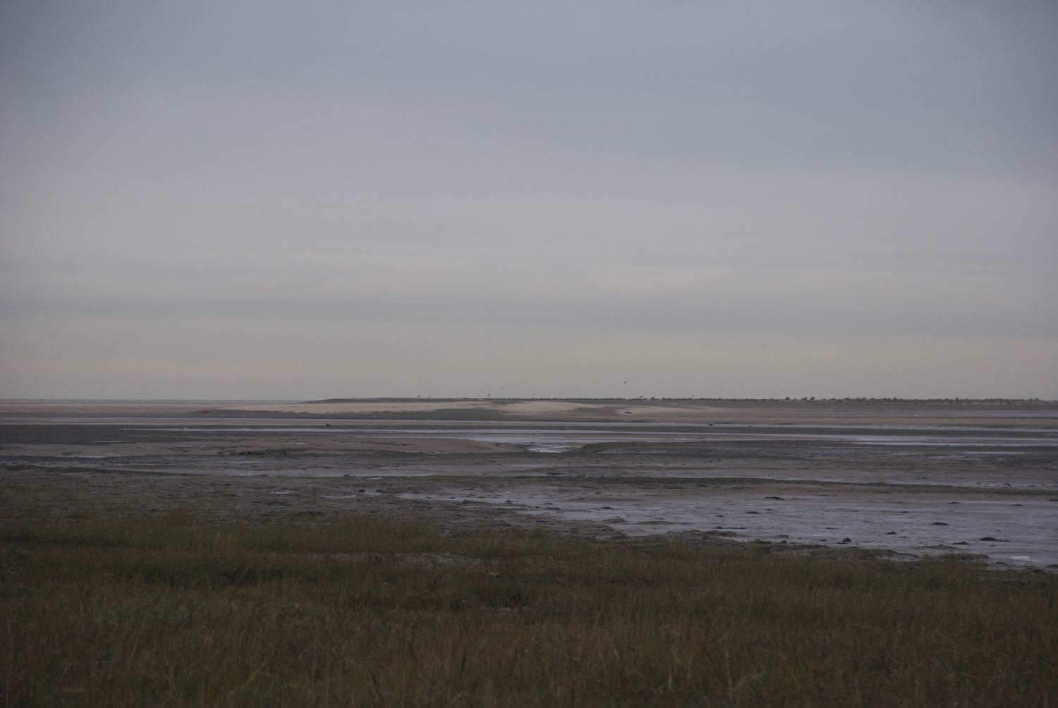 Twilight.  A very low tide in the Blakeney Channel (seen from the Morston side) made it look as though we could almost walk across to Blakeney Point.