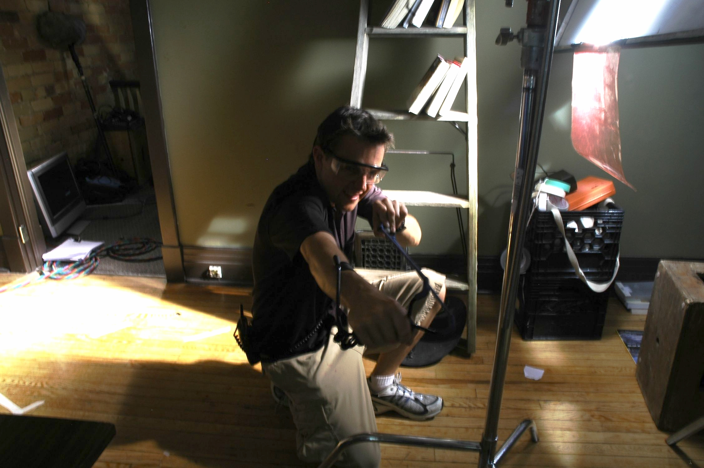 Producer Alex Jordan prepares to fire a rock into a fish tank…Seriously!