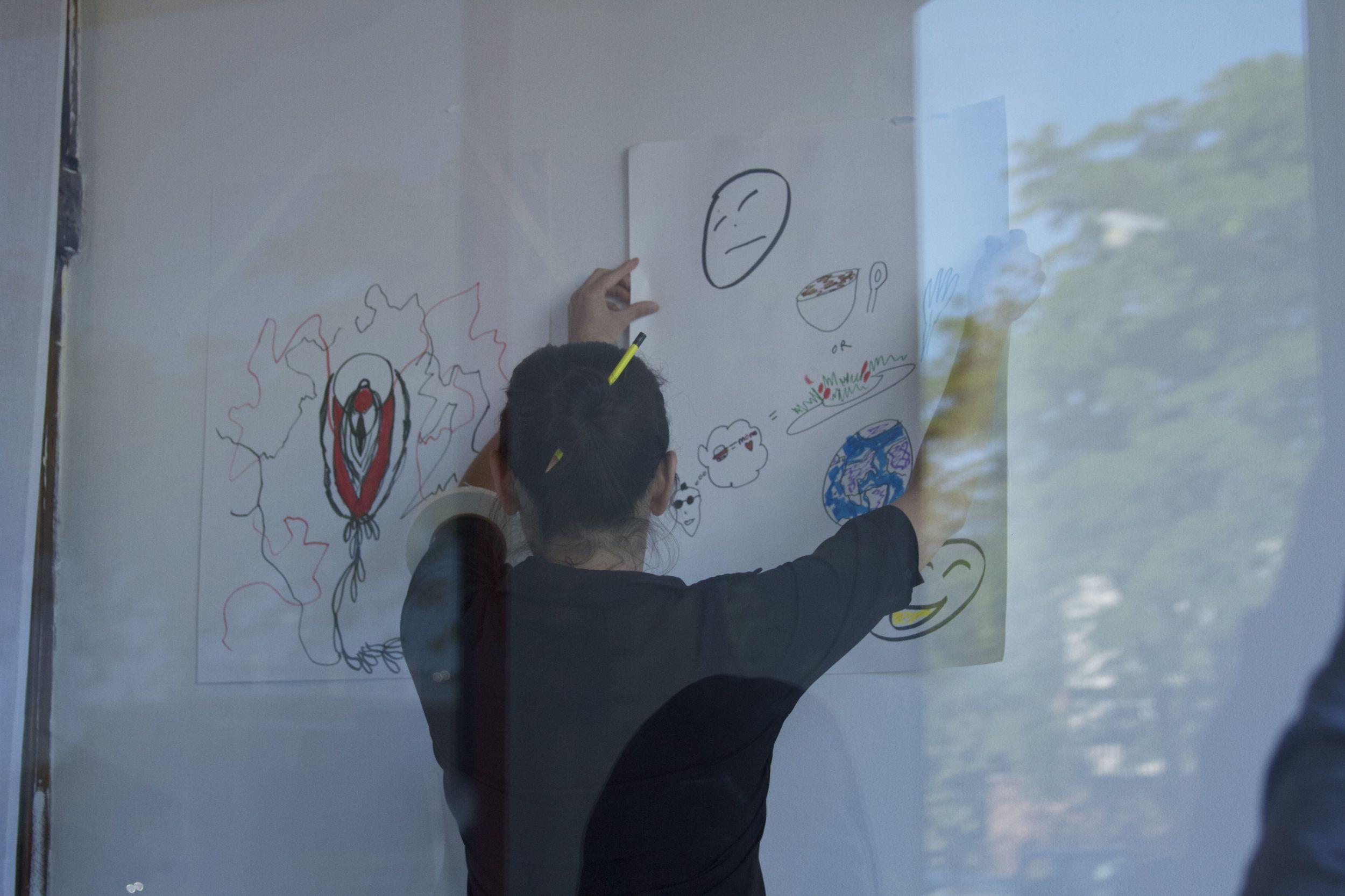 Nicole hanging drawings.jpg