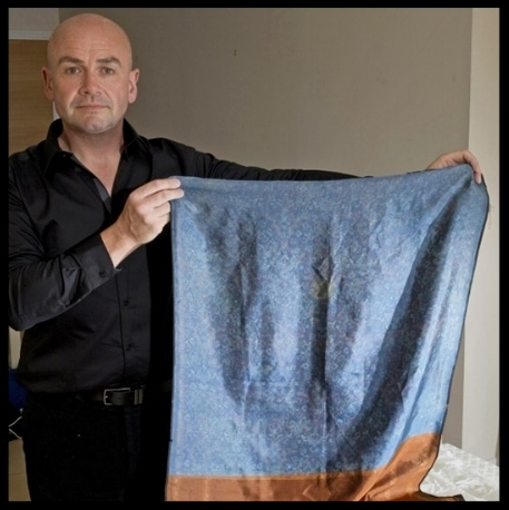 Russell Edwards, author of  Naming Jack the Ripper , holding up the shawl.