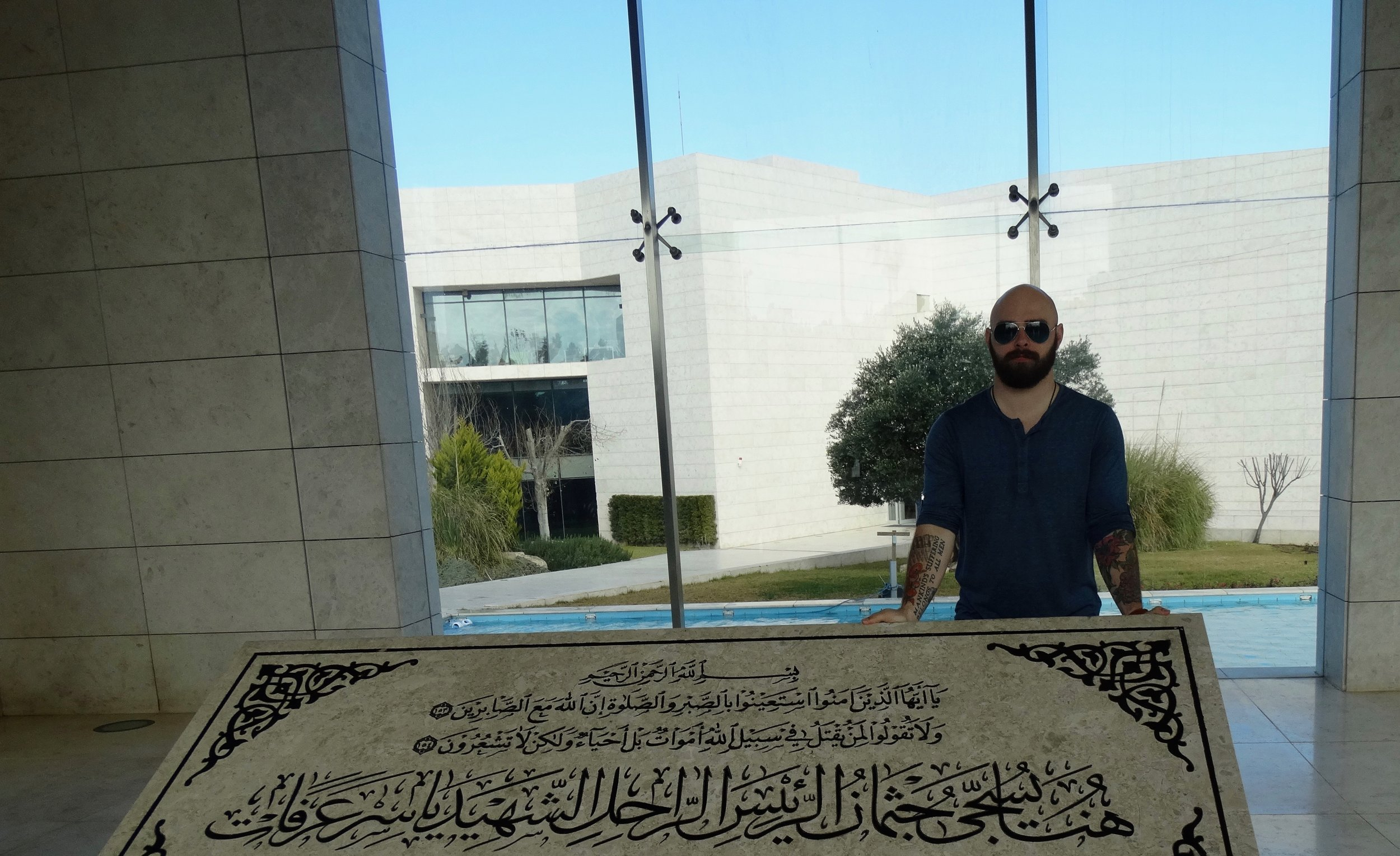 At Yasser Arafat's tomb. What a shithead.