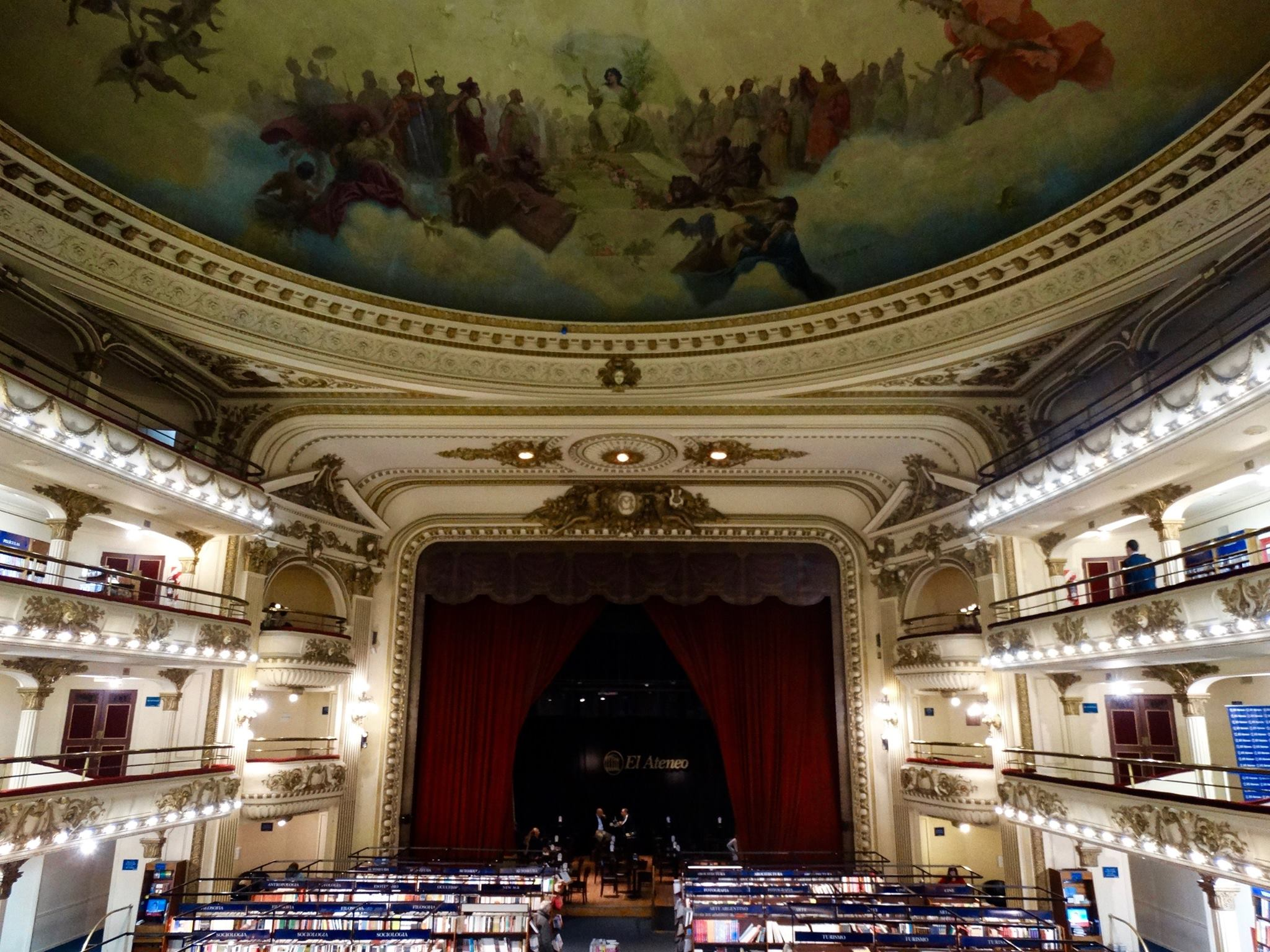 """El Ateneo Grand Splendid, rated """"The Most Beautiful Bookstore In The World"""" by The Guardian, used to be an opera house. Shelves line all three stories where the seating used to be, and a great café is situated on the stage."""