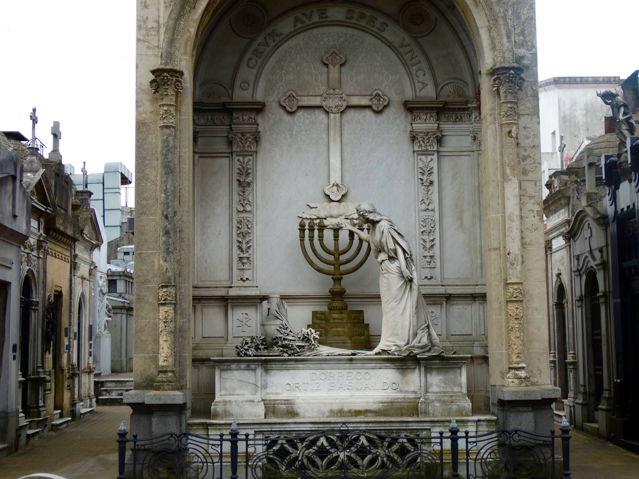 This mausoleum was actually pretty confusing to me. An angel or woman lighting a menorah under a cross?
