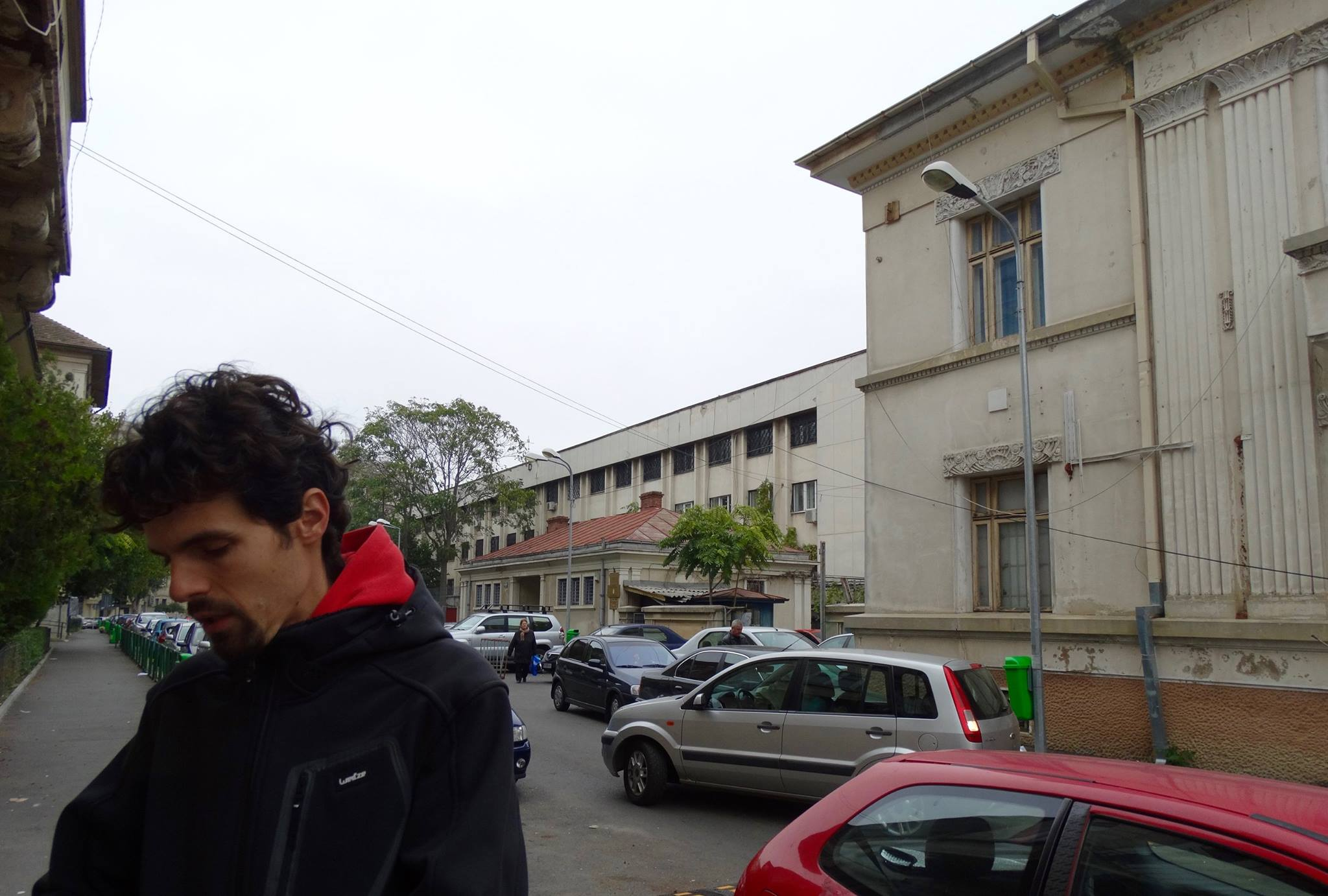 My tour guide Marius standing in front of two buildings used by the Securitate, communist Romania's secret police. In these two buildings, countless Romanian citizens were interrogated and tortured, and hundreds of thousands of other Romanians were turned into informants.