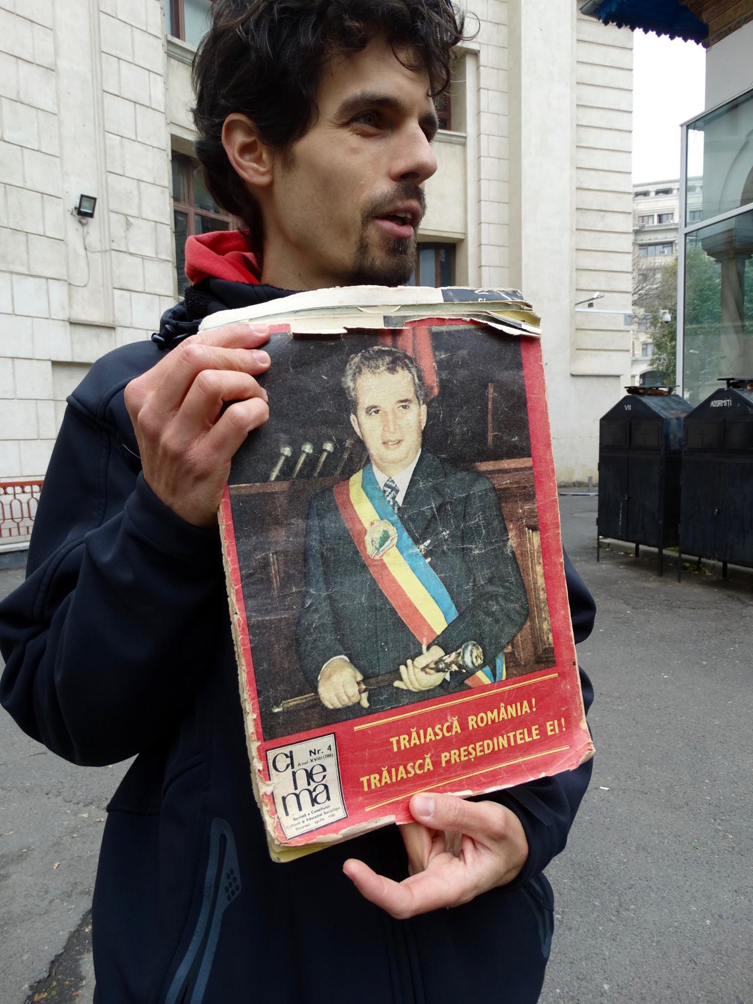 Tour guide Marius showing myself and the group Romanian communist propaganda, with an image of Nicolae Ceauşescu on the cover of a film magazine. According to Marius, the dictator was on the cover of every Romanian magazine, no matter what the subject. Women's lingerie?