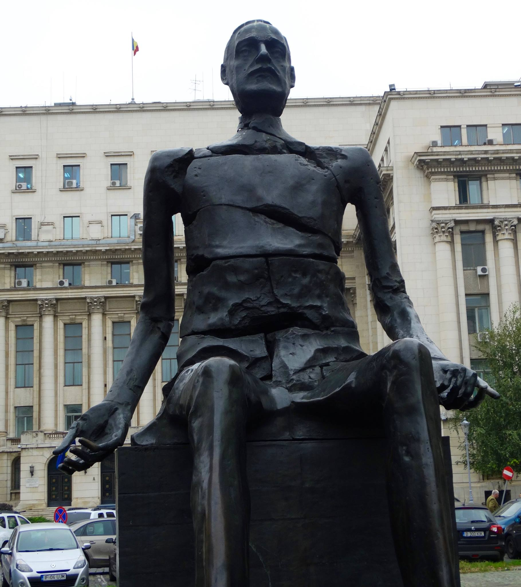 Statue of Luliu Maniu, an anti-communist politician in Romania, who stood for election against the Communist Party in 1946. It would be the last free election Romania would have until 1990.  A year after his loss (in what is commonly thought to have been a rigged election), the communists charged Maniu with treason and arrested him. He was sentenced to life in prison with hard labor, and would die six years later, after being kept in a pitch-black room for two of those years.  The cracks in the statue represent how this man broke himself for his country, and his outstretched arms signify his regret that it still wasn't enough to save it from dictatorship.