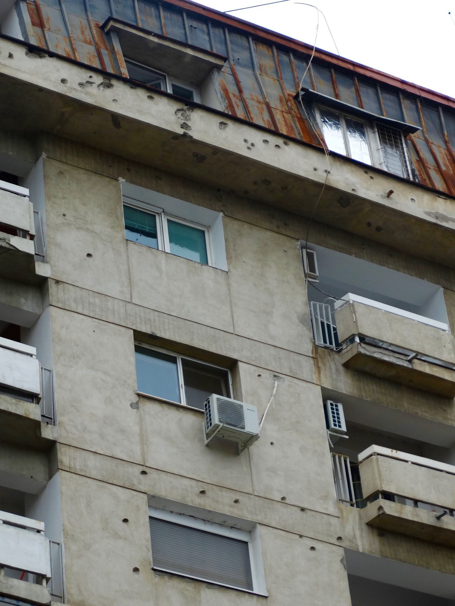Bullet holes from the revolt still remain on many Bucharest buildings.