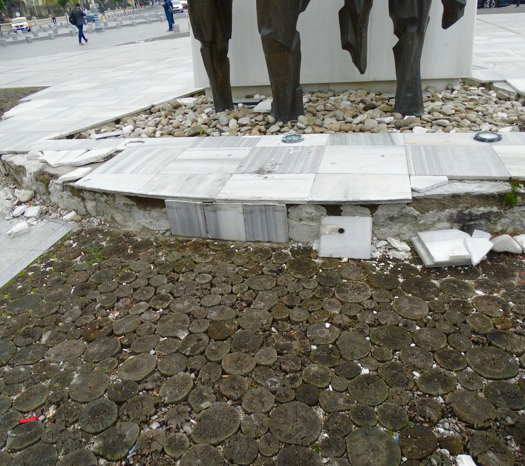 The path to the memorial is made up of cut-down trees, which symbolize the lives of Romanians who were killed while overthrowing Ceauşesu's regime. You will notice that some of the stumps are big and others are small. This represents the fact that both young and old sacrificed themselves in the revolution.