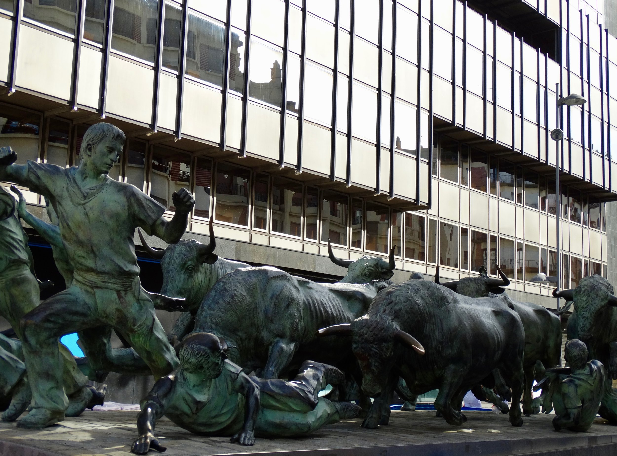 This is obviously a statue depicting the bull run, but I couldn't help but think that this could also be interpreted as Main Street meeting Wall Street.