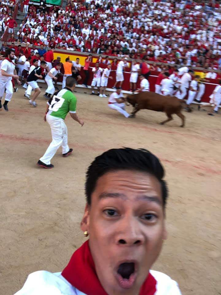 This awesome selfie was taken by a dude in my travel group at the arena (the end of the bull run, when pictures are allowed) and posted to Facebook.    I made it to the fifth round in the arena before getting taken out by a rowdy black bull and dragged about six or seven feet. Because of the adrenaline, I didn't notice the scrapes or bruising until a few hours later.