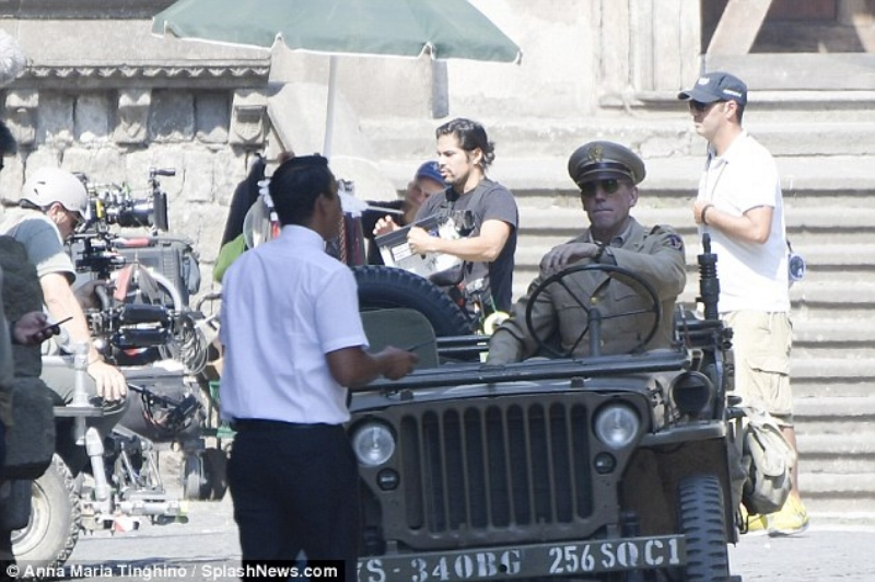 Roaming the streets! Filming took place across two locations, the Piazza San Lorenzo and Pizza del Plebiscito, on Thursday  Taking a moment to himself between shooting scenes, the actor took off his Major's hat while he walked around the Italian city.  The Night Manager star was seen toting a water bottle as he kept hydrated in the sweltering heat and a book.  Catch 22 takes viewers back to Italy during the landscape of World War 2.