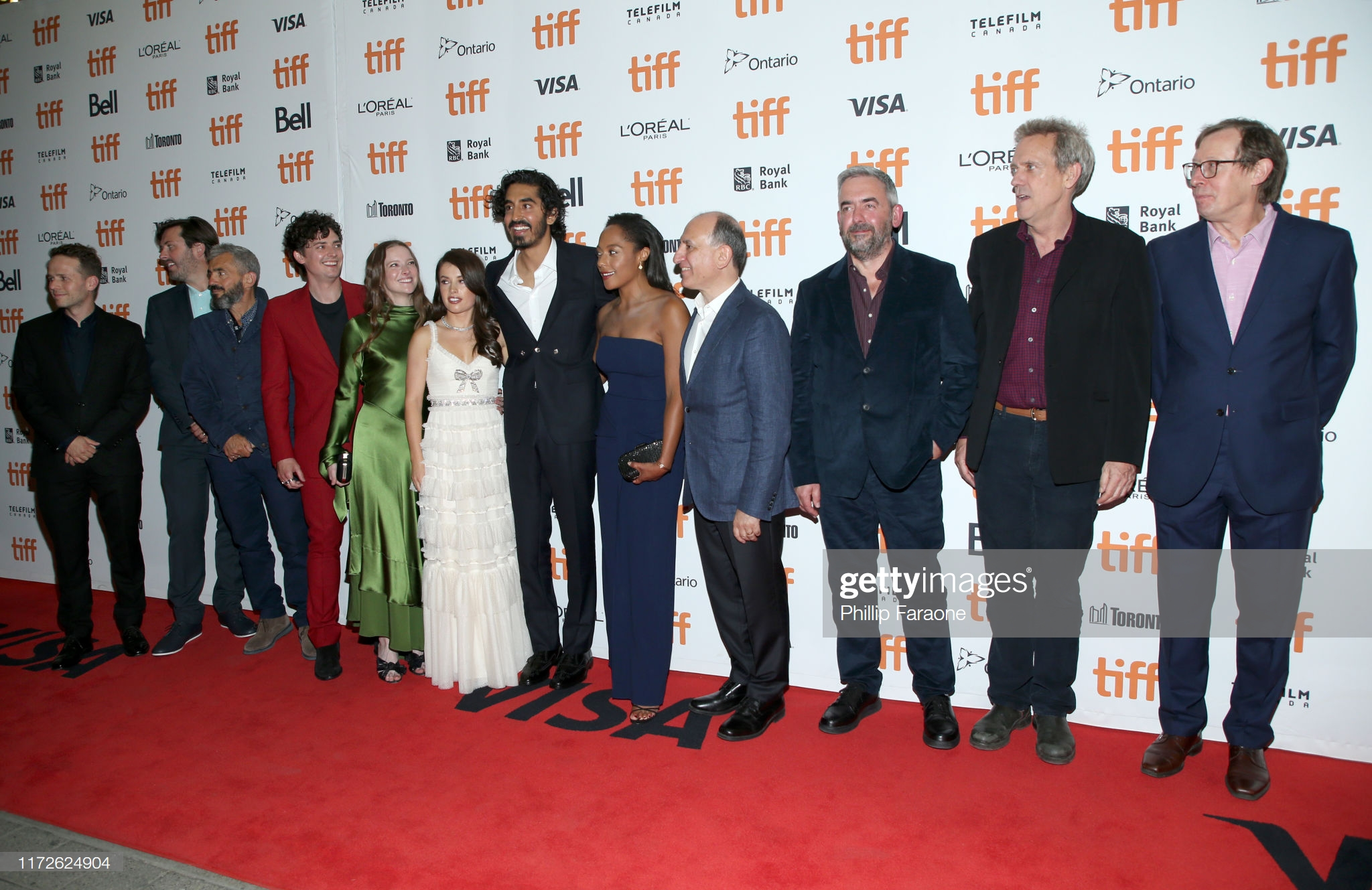 """TORONTO, ONTARIO - SEPTEMBER 05: (L-R) -Ollie Madden, Ben Browning, Daniel Battsek, Aneurin Barnard, Morfydd Clark, Aimee Kelly, Dev Patel, Rosalind Eleazar, Armando Iannucci, Simon Blackwell, Hugh Laurie and Kevin Loader attend """"The Personal History Of David Copperfield"""" premiere during the 2019 Toronto International Film Festival at Princess of Wales Theatre on September 05, 2019 in Toronto, Canada. (Photo by Phillip Faraone/Getty Images)"""