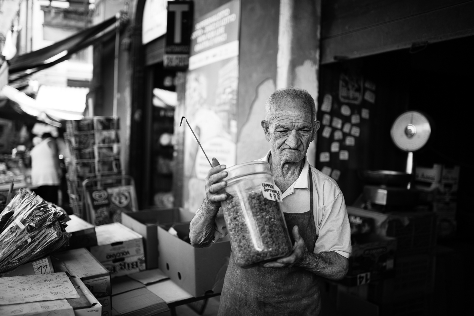 Catania local market. A man with a big capers can