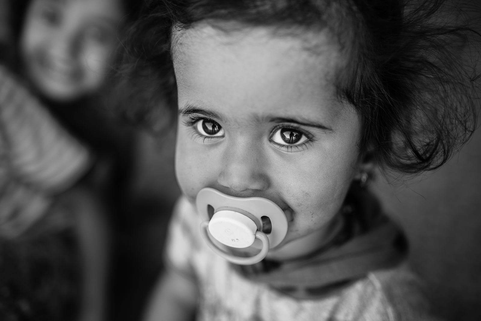 The big eyes of a little girl in an ex-school of Erbil