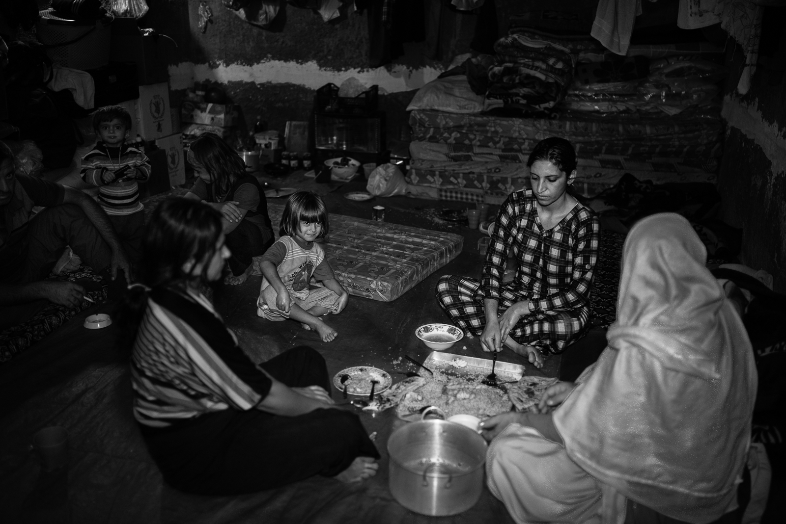 A family inside a building under construction in Zakho