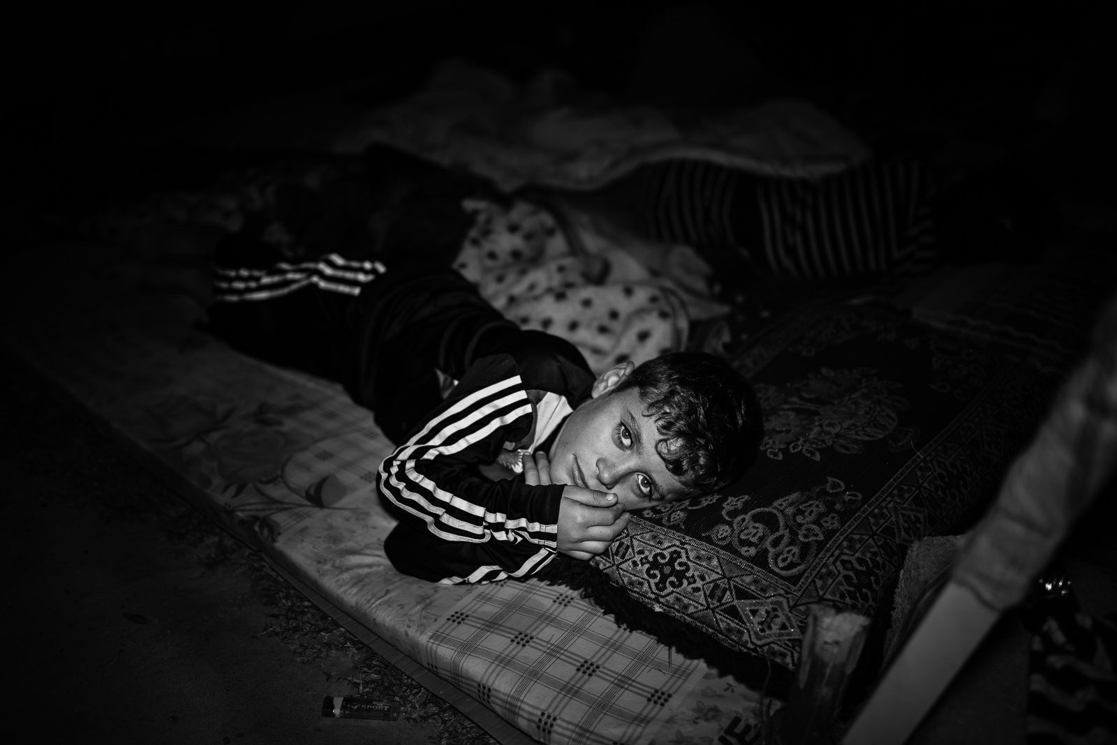 A little boy sleep on the floor out of a school in Zakho