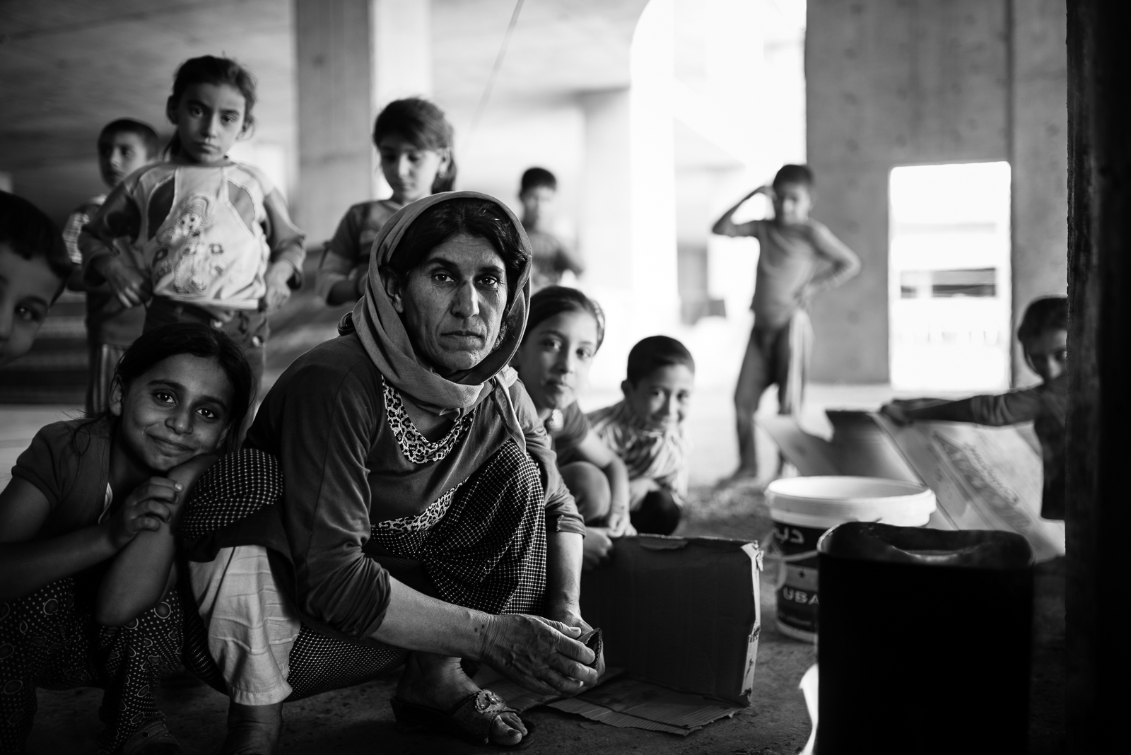 Yazidi mother and children in Zakho under construction building