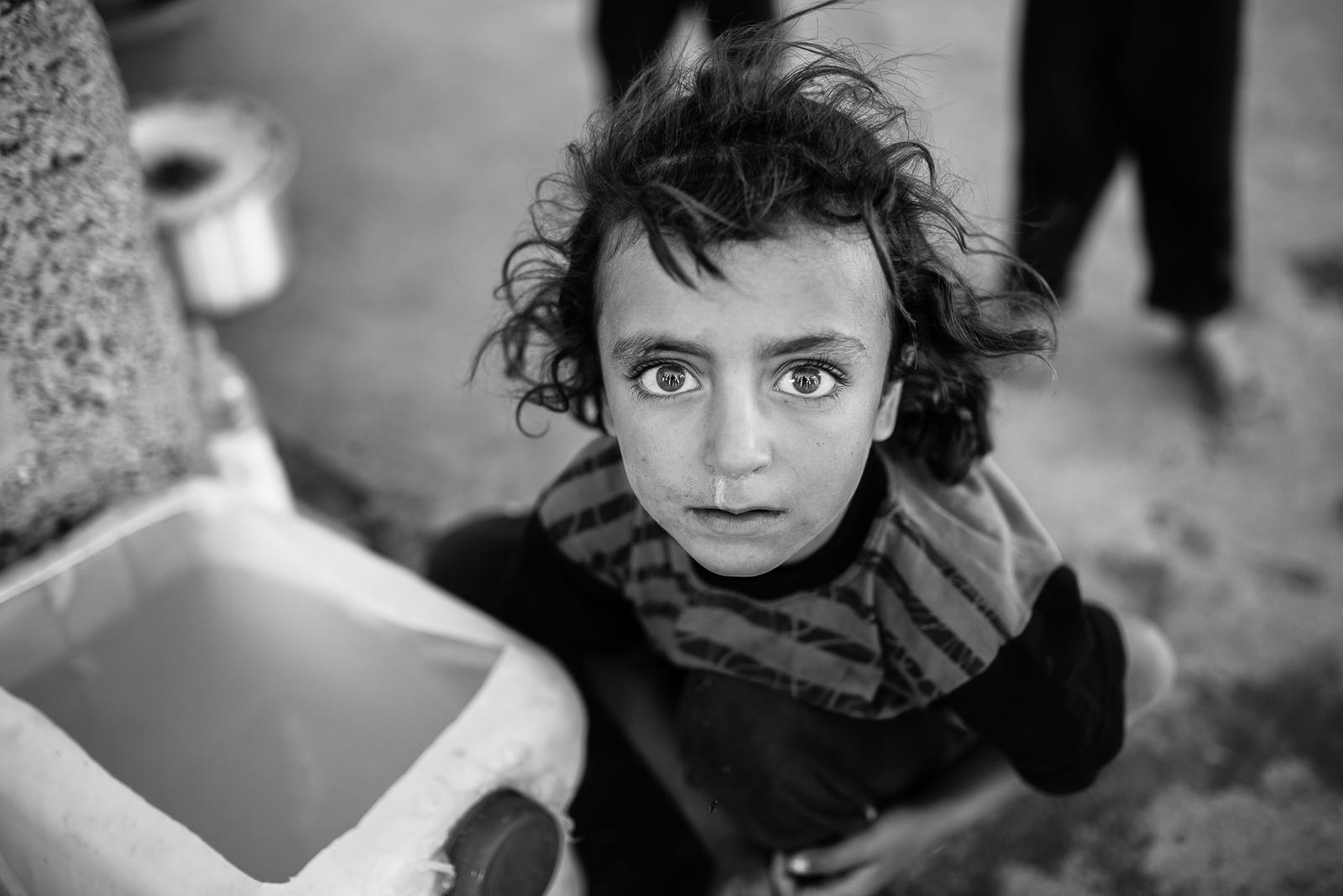 Little girl inside an under construction building in Zakho