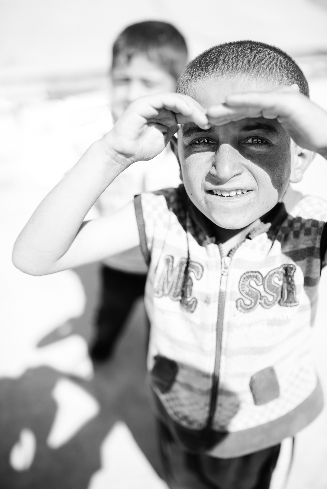 Children under the sun in a small refugees camp in Erbil