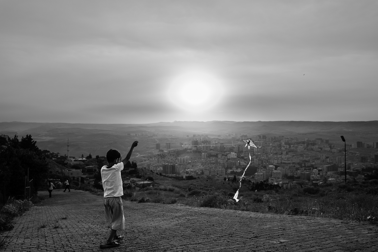 A children and his kite above Mardin. The video of this photo is  here