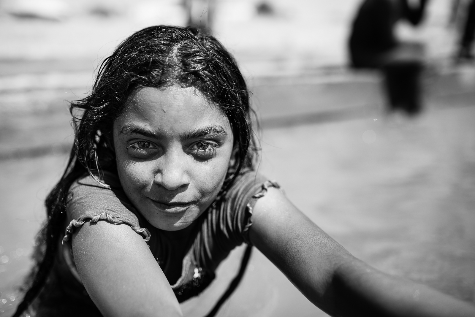 A syrian girl play in a water canal close to a refugees camp outside the Tal Abyad border. The video of this photo is  here