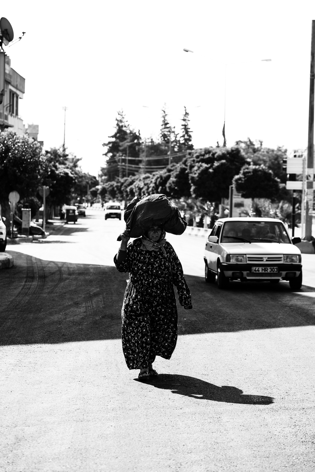 "A woman carry her ""bag"" outside the syrian border to Kilis. The video of this photo is  here"