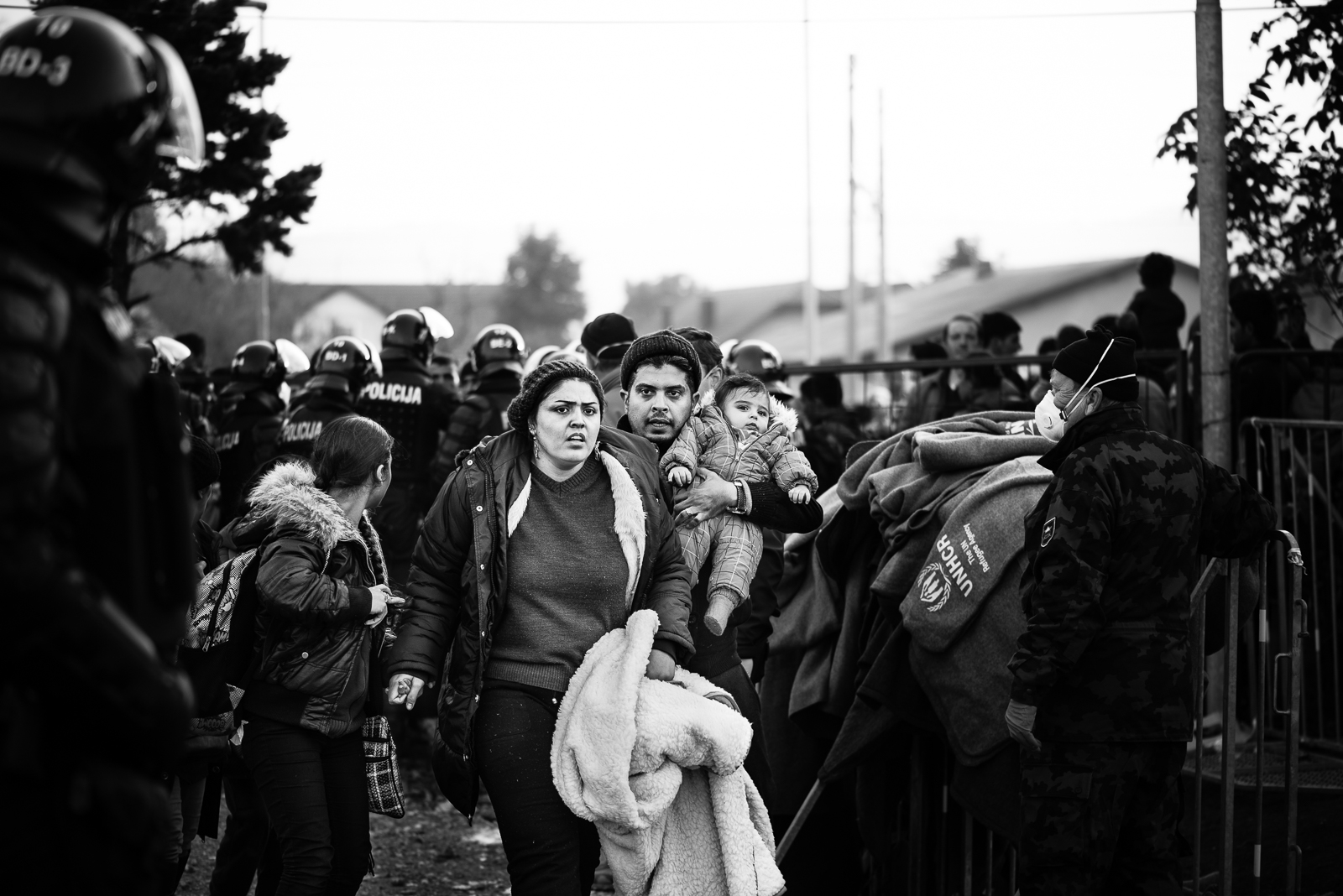 A family of migrants while they are transferring to train station in order to go to Austrian border