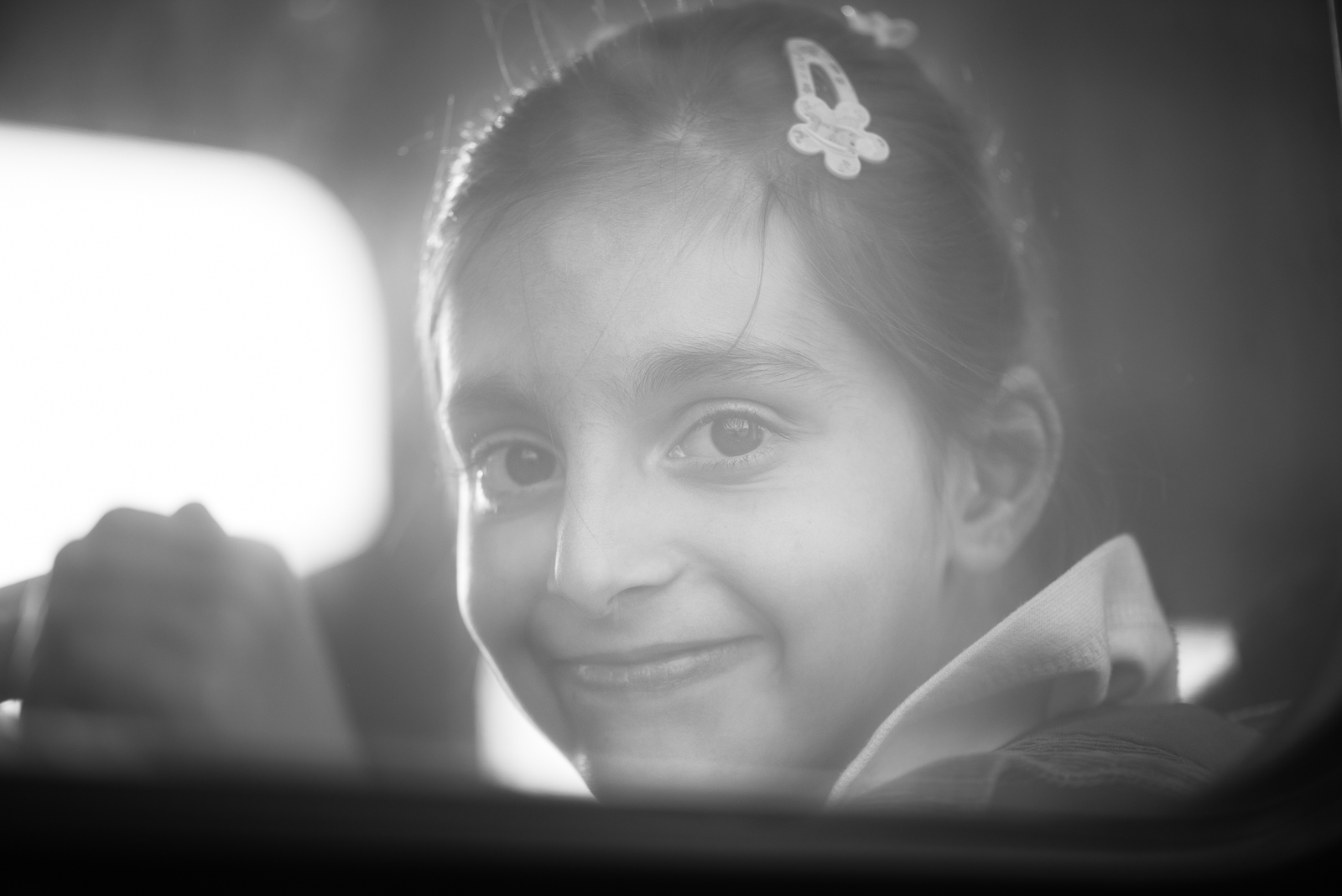 The gaze of a syrian little girl through the bus window