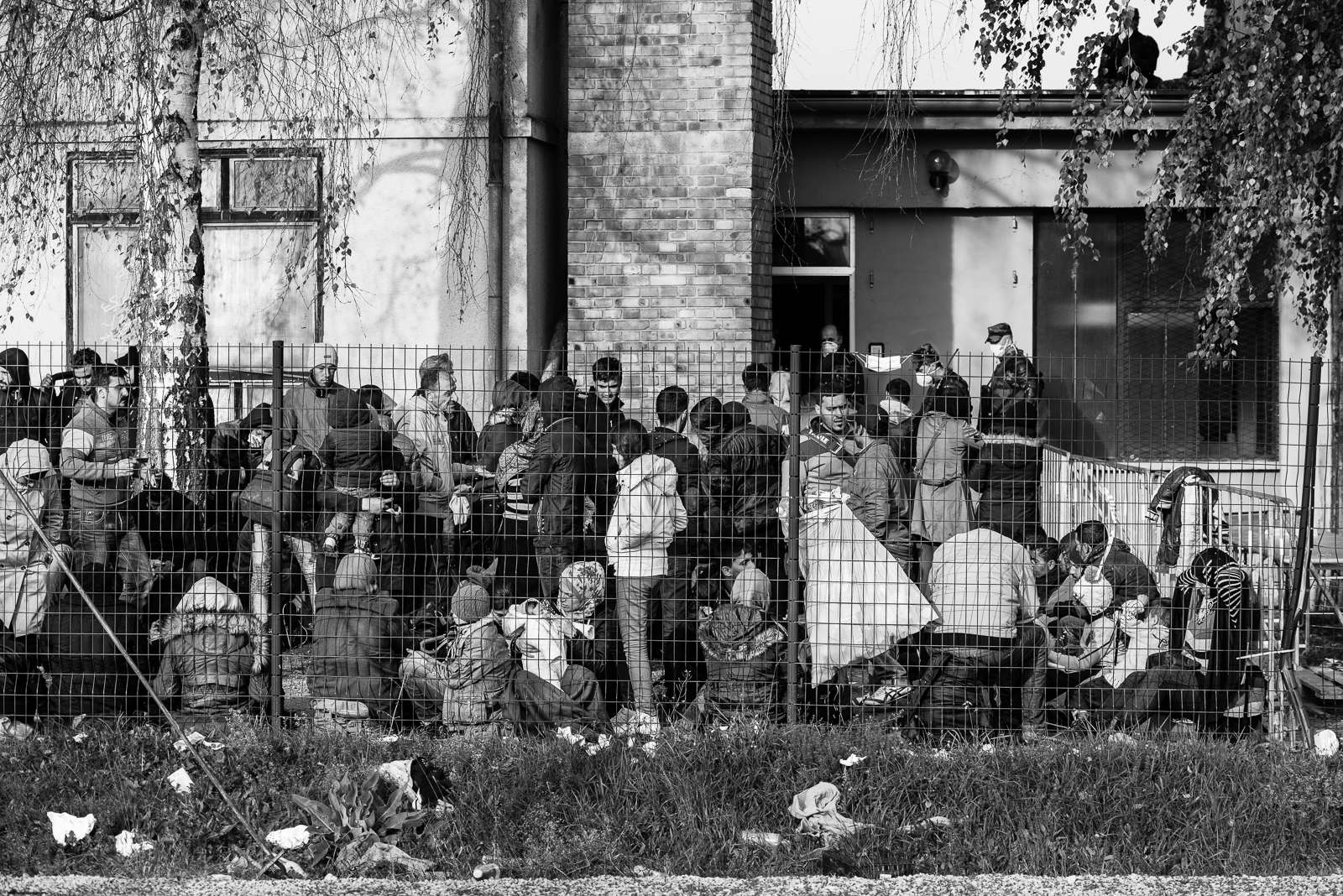 Migrants behind the fence of a camp