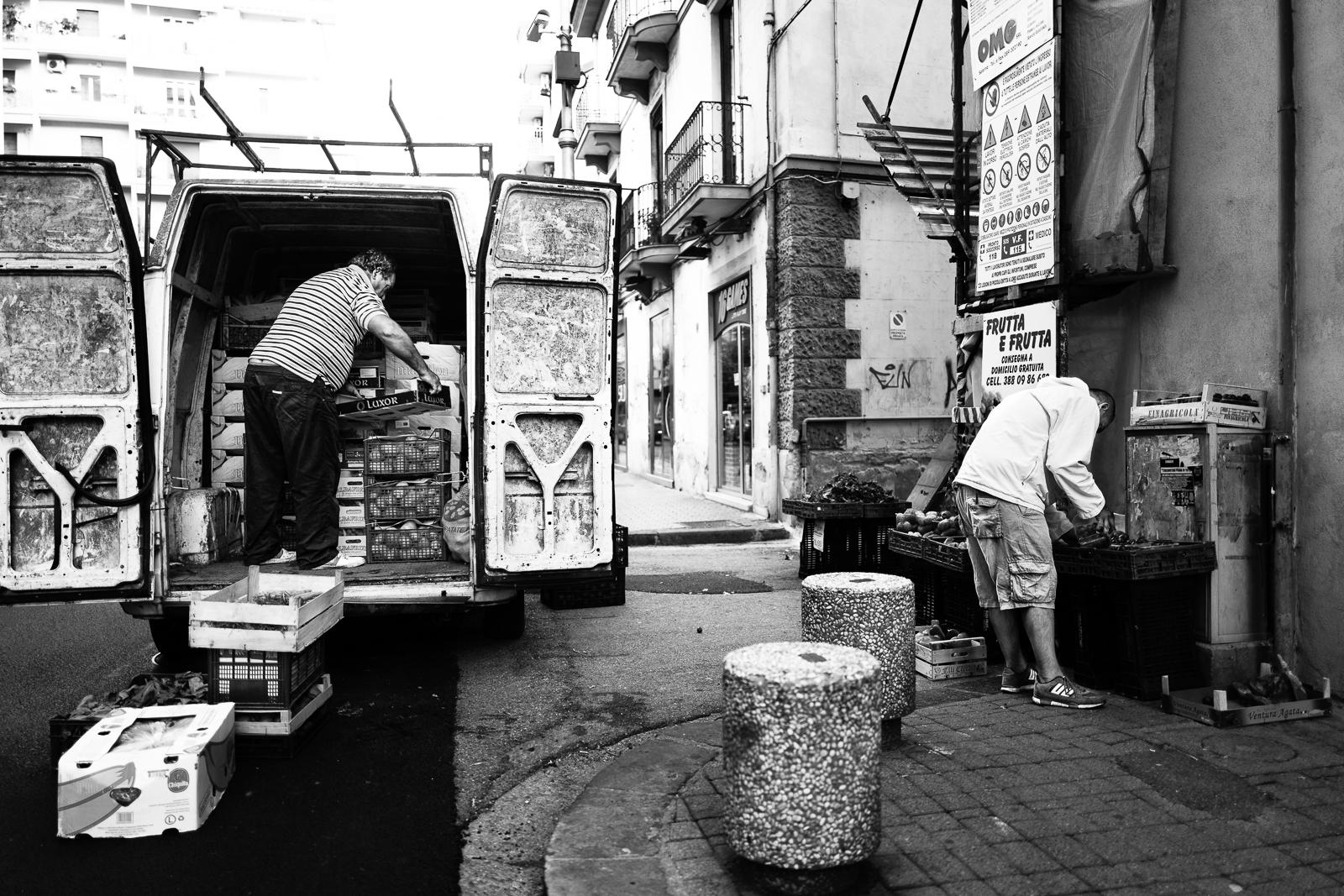 Two men are preparing the local market