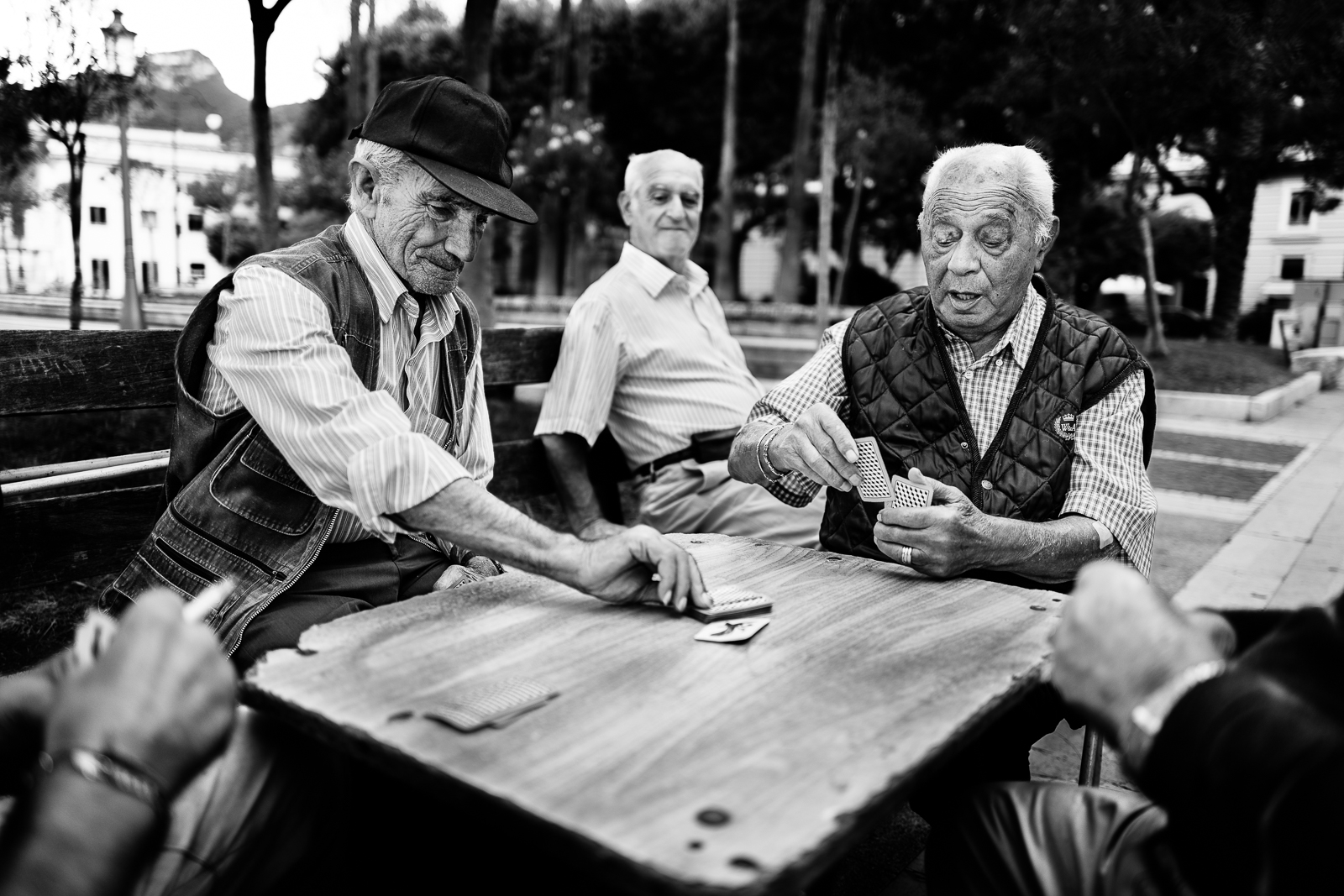 Friends are playing card on the promenade