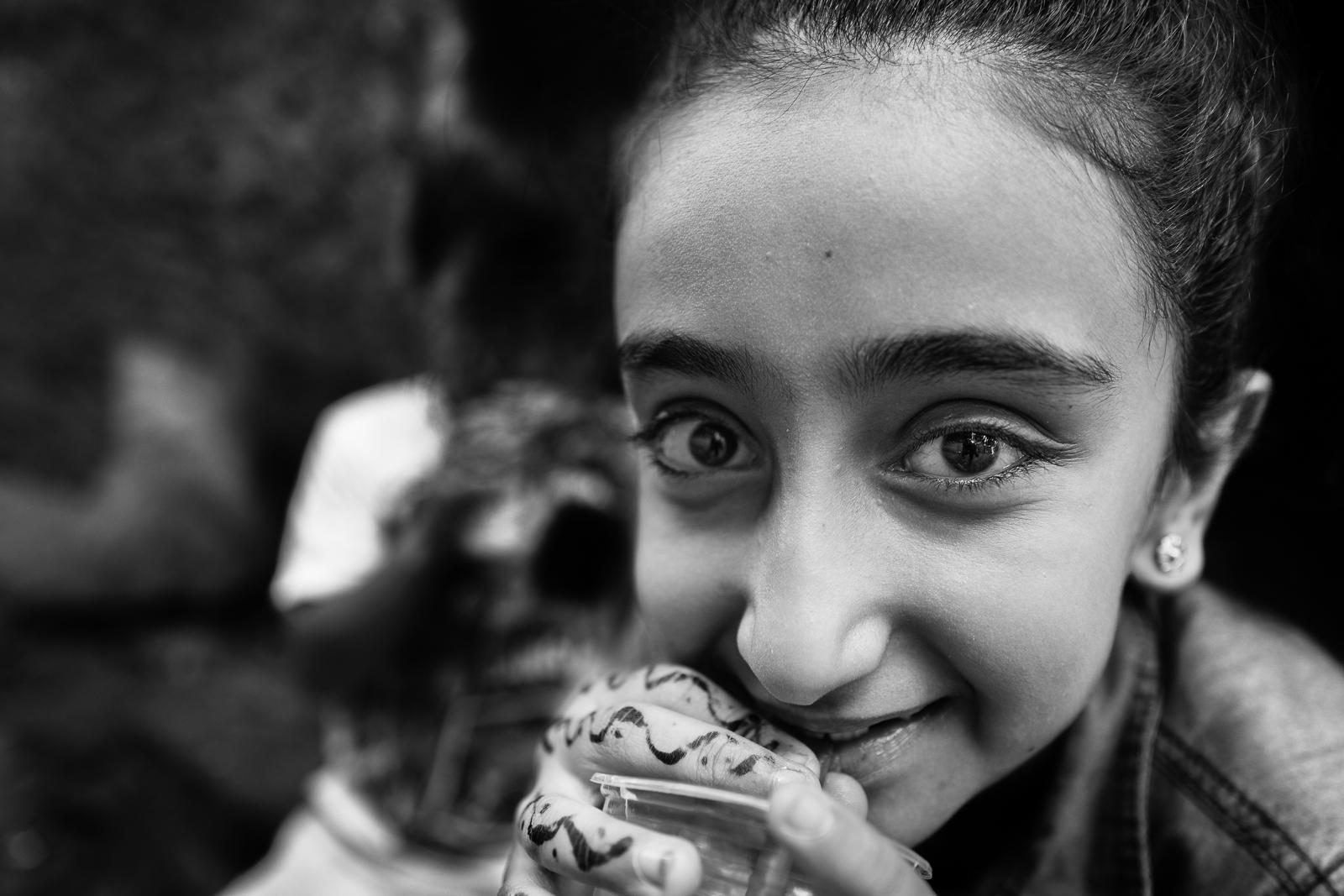 Little kurdish girl is drinking in Diyarbakir, Turkey