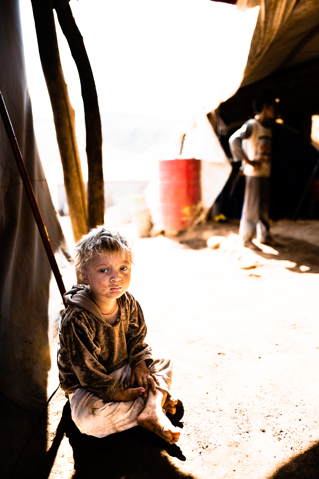 A child is learning how to avoid booby traps from an ONG. Sinjar mount