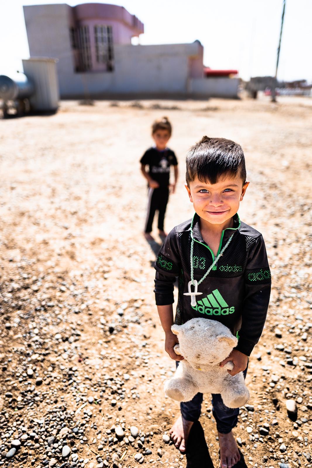 A little yazidi boy and his teddy bear. Unofficial camp in Sharya, near Dohuk