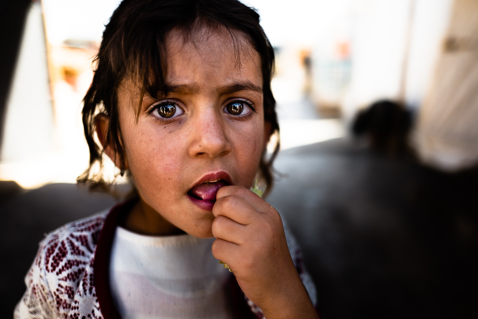 A little girl surprised to see me in the refugees camp of Khanik, near Douhk