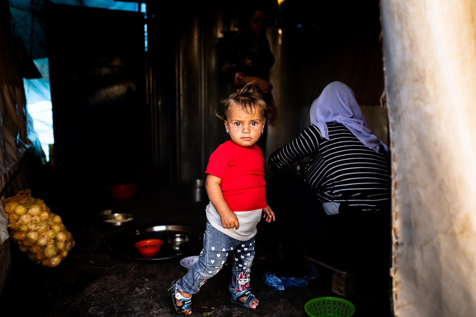 A little girl inside her tent in the refugees camp of Khanik, near Douhk