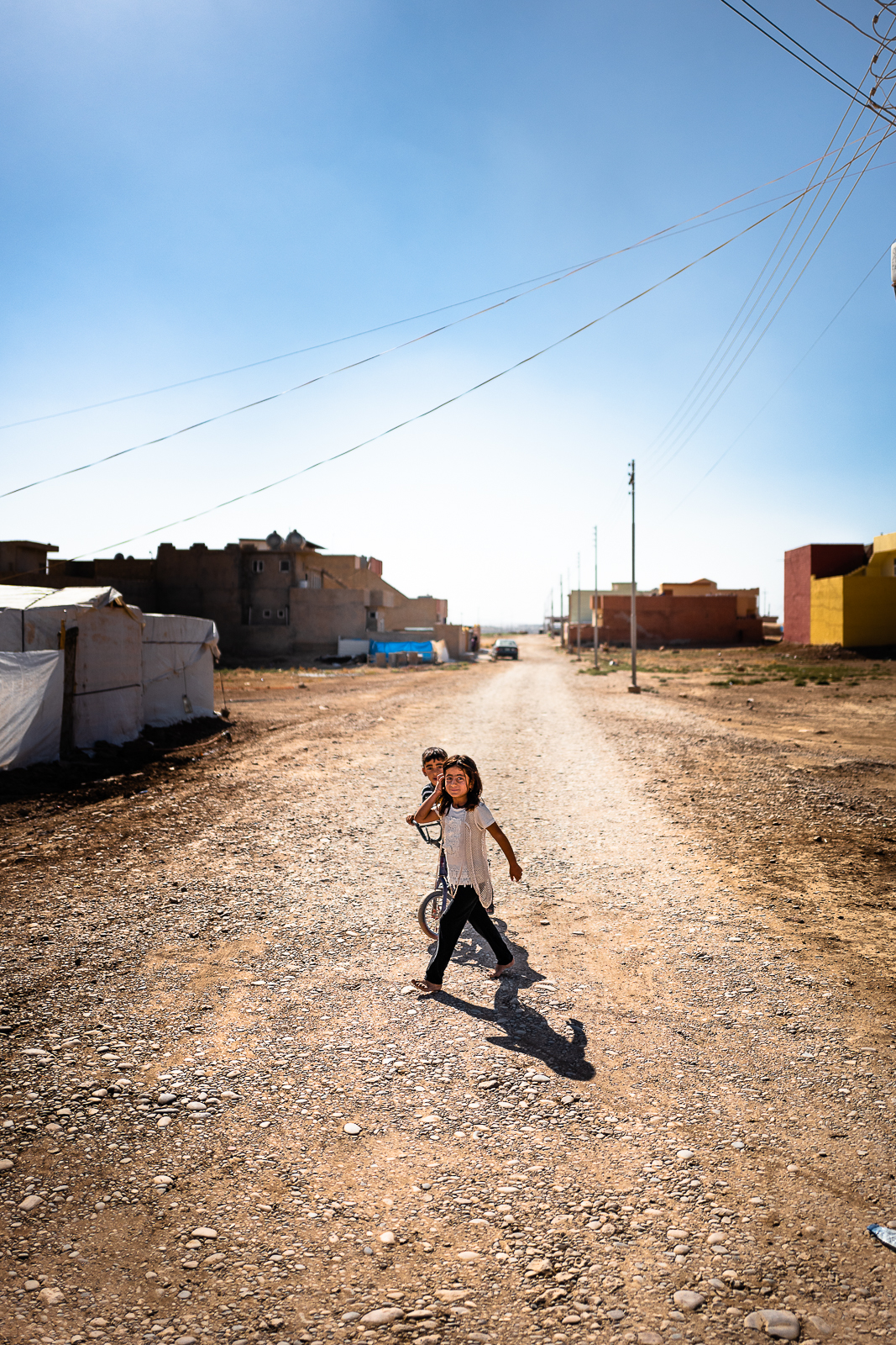 Two curious children in the unofficial camp in Sharya, near Dohuk