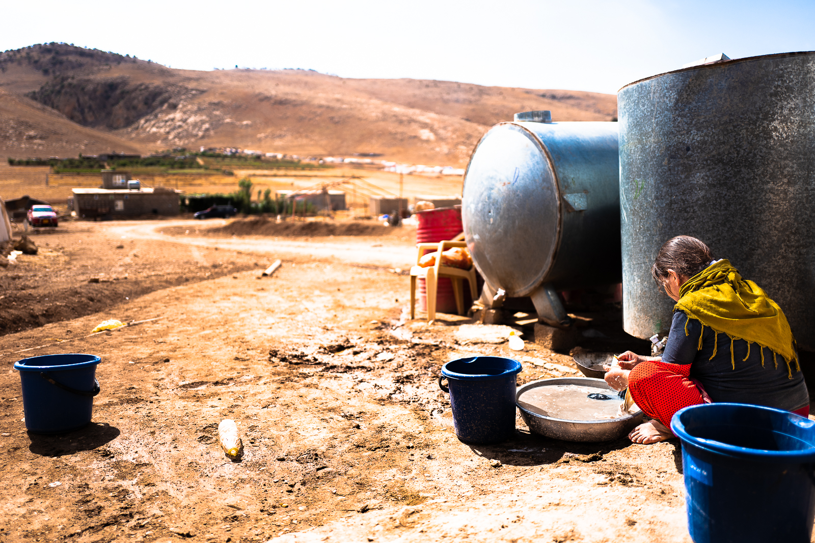 A mother is washing her clothes in Mount Sinjar
