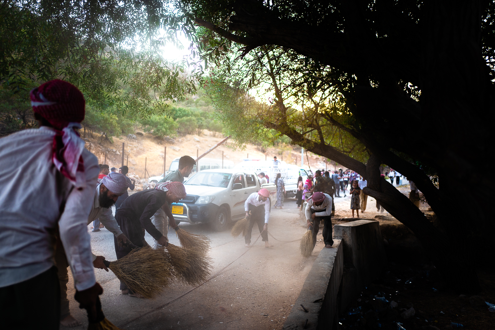 Men are cleaning the floor near Lalish, because you must enter in the  village barefoot